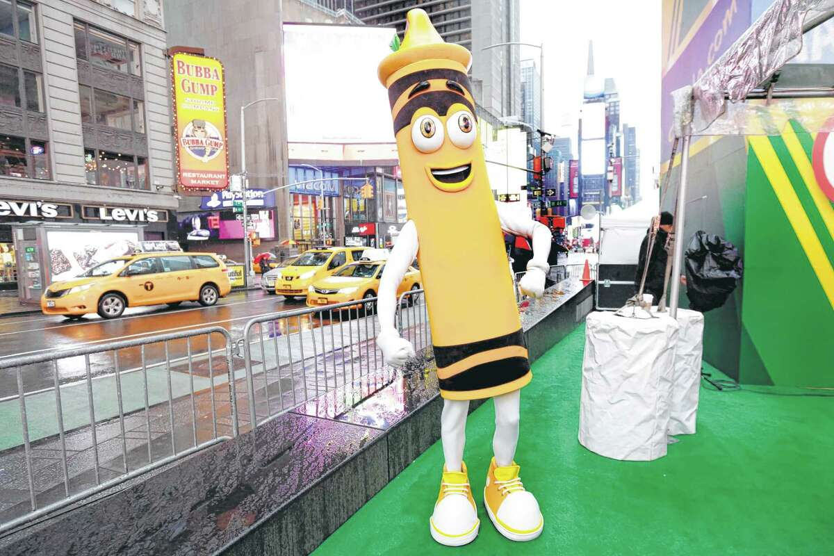 A dandelion crayon character makes an appearance during a Crayola event in New York's Times Square.