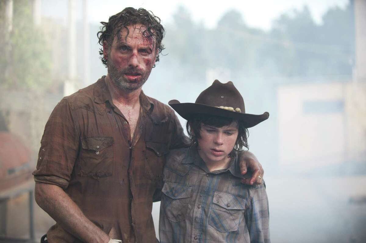 Rick Grimes (Andrew Lincoln) and Carl Grimes (Chandler Riggs) in Season 4, Episode 8 of The Walking Dead.