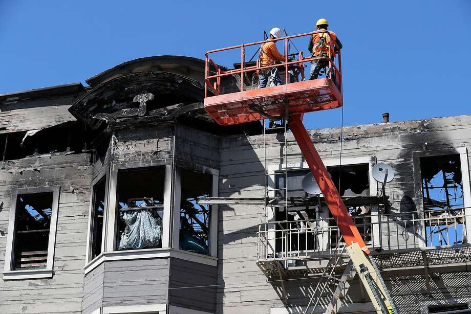 Workers begin to stabilize the structure, on Fri. Mar. 31, 2017, by removing any loose debris that may be a falling hazard from the halfway house in West Oakland, Ca. that burned last Monday killing 4 people in the fire. Photo: Michael Macor, The Chronicle
