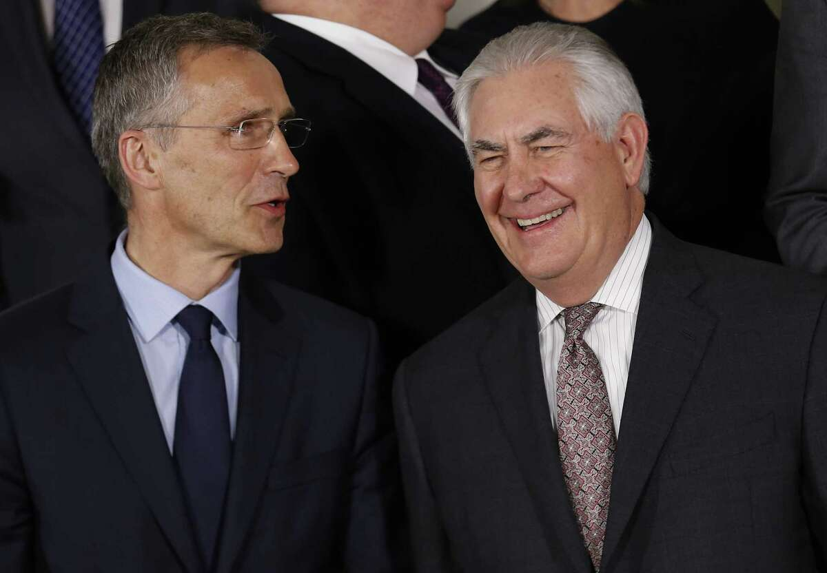 NATO Secretary-General Jens Stoltenberg, left, talks with Secretary of State Rex Tillerson at a NATO foreign ministers meeting in Brussels, where officials said they were reassured by Tillerson's rebuke of Russia.