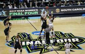Stanford forward Erica McCall (24) and South Carolina forward A'ja Wilson (22) jump for the opening tipoff during an NCAA college basketball game in the semifinals of the women's Final Four, Friday, March 31, 2017, in Dallas. (AP Photo/Eric Gay)