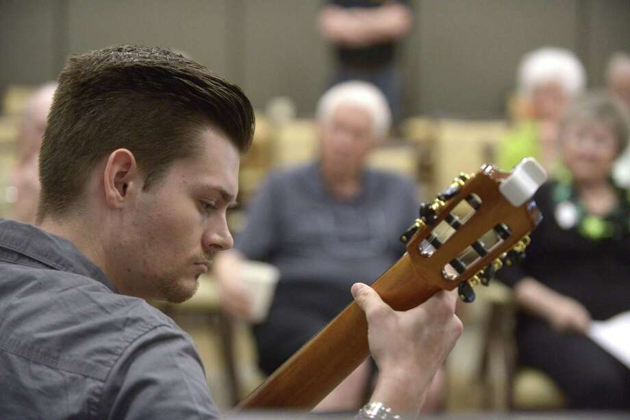 Sean Kithas plays classical guitar for residents of Franklin Park Alamo Heights on Friday, March 17, 2017. He is  a music student at the University of Texas at San Antonio and is participating in Franklin Park's musician-in-residence program. Photo: Billy Calzada, Staff / San Antonio Express-News / San Antonio Express-News