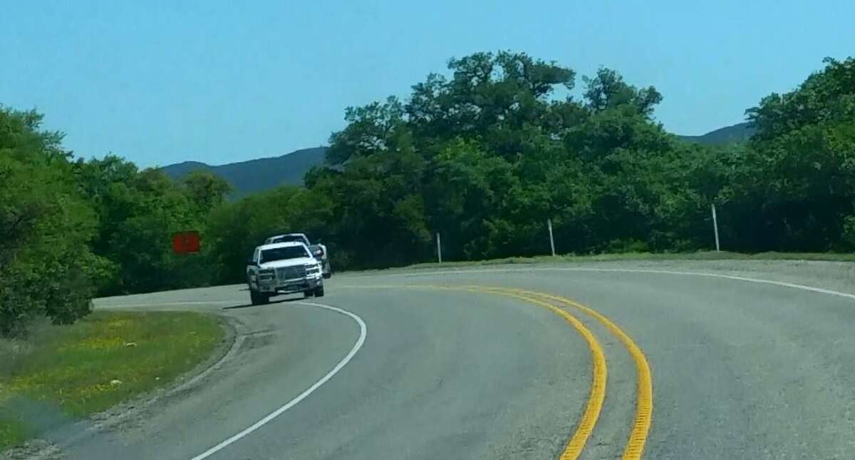A white truck moves back and forth on two lanes of U.S. 83 in Uvalde County near Concan minutes before it crashed into a bus on March 29, 2017, as seen in a 15-minute video obtained by mySA.com. Oncoming traffic could be seen swerving out of its way before the crash.