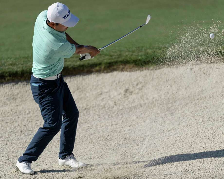 Sung Kang hitting out of a sand trap on the 18th green during the second round of the Shell Houston Open golf tournament Friday, March 31, 2017, at The Golf Club of Houston in Humble, Texas. (Wilf Thorne/Houston Chronicle via AP) Photo: Wilf Thorne, MBO / ' 2017 Houston Chronicle