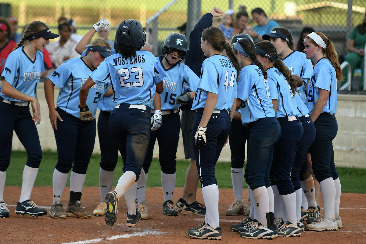 Kingwood junior shortstop Jourdyn Campbell (23) prepares for her greeting at homeplate after homering against Atascocita in the bottom of the third inning of theiir District 21-6A matchup at Kingwood High School on Friday, March 31, 2017. (Photo by Jerry Baker/Freelance)