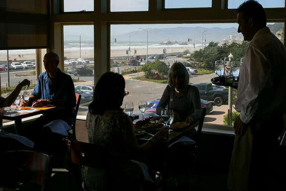 The diners enjoy the views of Ocean Beach at Beach Chalet Brewery & Restaurant in San Francisco, Calif. Friday, March 31, 2017.