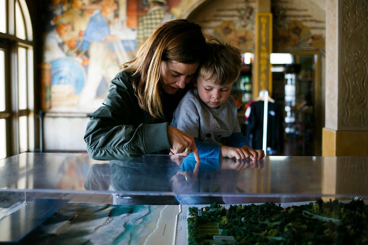 Kristen Sager holds up her five-year-old son Magnus Nyberg, to look at the scale model of Golden Gate Park at Beach Chalet in San Francisco, Calif. Friday, March 31, 2017.