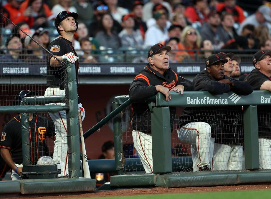 Giants catcher Buster Posey and manager Bruce Bochy are eager to begin pursuit of another World Series ring. Photo: Scott Strazzante, The Chronicle