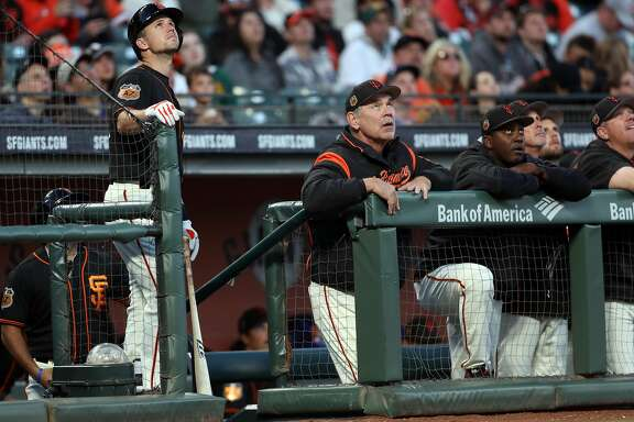 San Francisco Giants' Buster Posey and manager Bruce Bichy watch a pop up in 1st inning against Oakland Athletics during Bay Bridge Series at AT&T Park in San Francisco, Calif., on Friday, March 31, 2017.