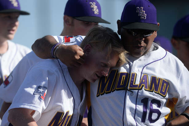 Midland High's Michael Hailey (14) is congratulated by assistant coach Bobby Alvarez after scoring against Lee on March 31, 2017, at Zachery Field. James Durbin/Reporter-Telegram
