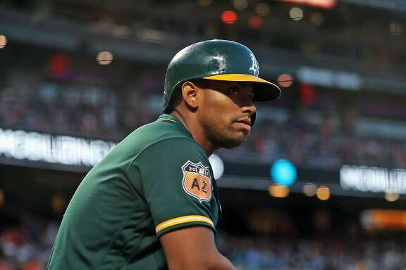 Oakland Athletics' Khris Davis in 2nd inning against San Francisco Giants during Bay Bridge Series at AT&T Park in San Francisco, Calif., on Friday, March 31, 2017.