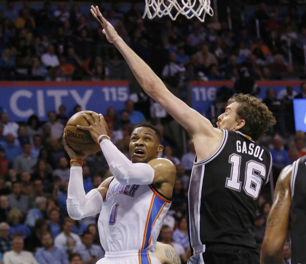 Oklahoma City Thunder guard Russell Westbrook (0) goes up for a shot as San Antonio Spurs center Pau Gasol (16) defends in the second quarter of an NBA basketball game in Oklahoma City, Friday, March 31, 2017. (AP Photo/Sue Ogrocki)