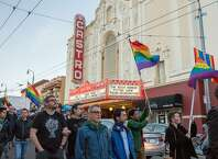 People march in the Castro for Gilbert Baker on Friday, March 31, 2017, in San Francisco, Calif. Friends said Baker, age 65, who is the creator of the rainbow flag, died Thursday in his sleep at his home in New York. The rainbow flag has become a symbol of the LGBT community recognized worldwide � celebrated at pride festivals, brandished at protests and raised every morning at the corner of Castro and Market streets.
