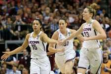 DALLAS, TX - MARCH 31:  Gabby Williams #15, Natalie Butler #51, Katie Lou Samuelson #33 of the Connecticut Huskies celebrate in the first half against the Mississippi State Lady Bulldogs during the semifinal round of the 2017 NCAA Women's Final Four at American Airlines Center on March 31, 2017 in Dallas, Texas.
