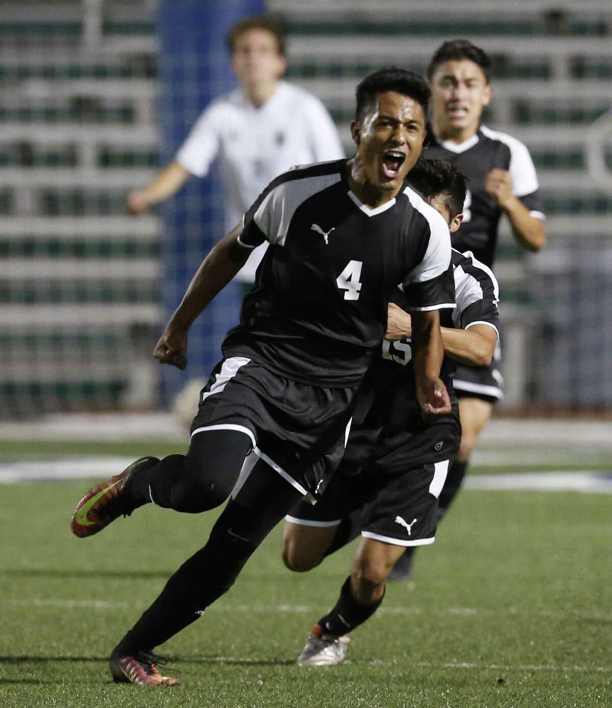 Clark's Angel Caballero reacts after scoring the first goal against Reagan in the Cougars' victory Friday.