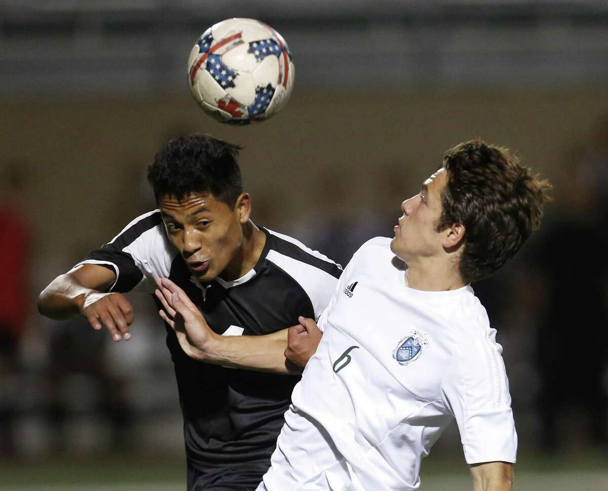 Clark's Angel Caballero (left) and Reagan's Jacob Galan (06) compete for the ball in 6A second-round boys soccer at Farris Stadium on Friday, Mar. 31, 2017. (Kin Man Hui/San Antonio Express-News)