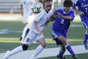 Johnson's Ashton Bynum (21) fights for control of the ball against New Braunfels' Andres Uribe (02) in 6A second-round boys soccer at Farris Stadium on Friday, Mar. 31, 2017. (Kin Man Hui/San Antonio Express-News)