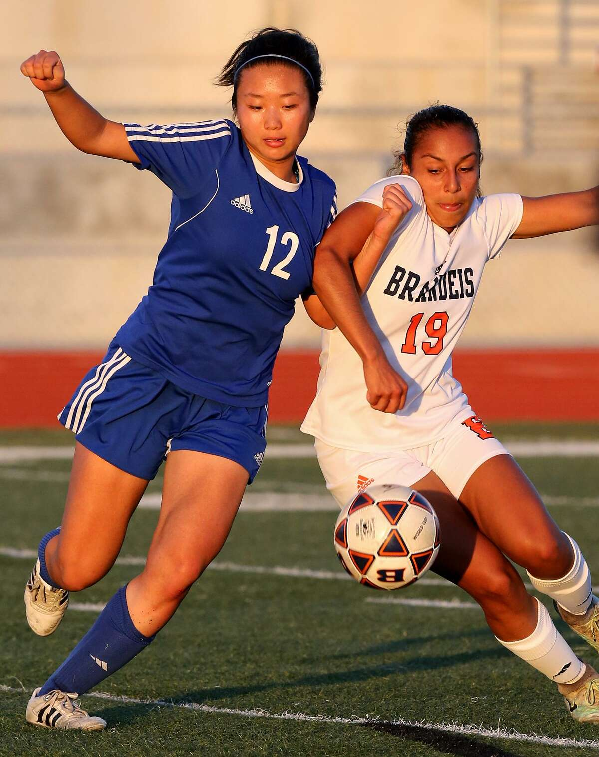 Austin Westlake's Victoria Lee and Brandeis' Marissa Arias chase after the ball during their Class 6A second-round playoff game held Friday March 31, 2017 at Steele High School. Westlake won 2-1.