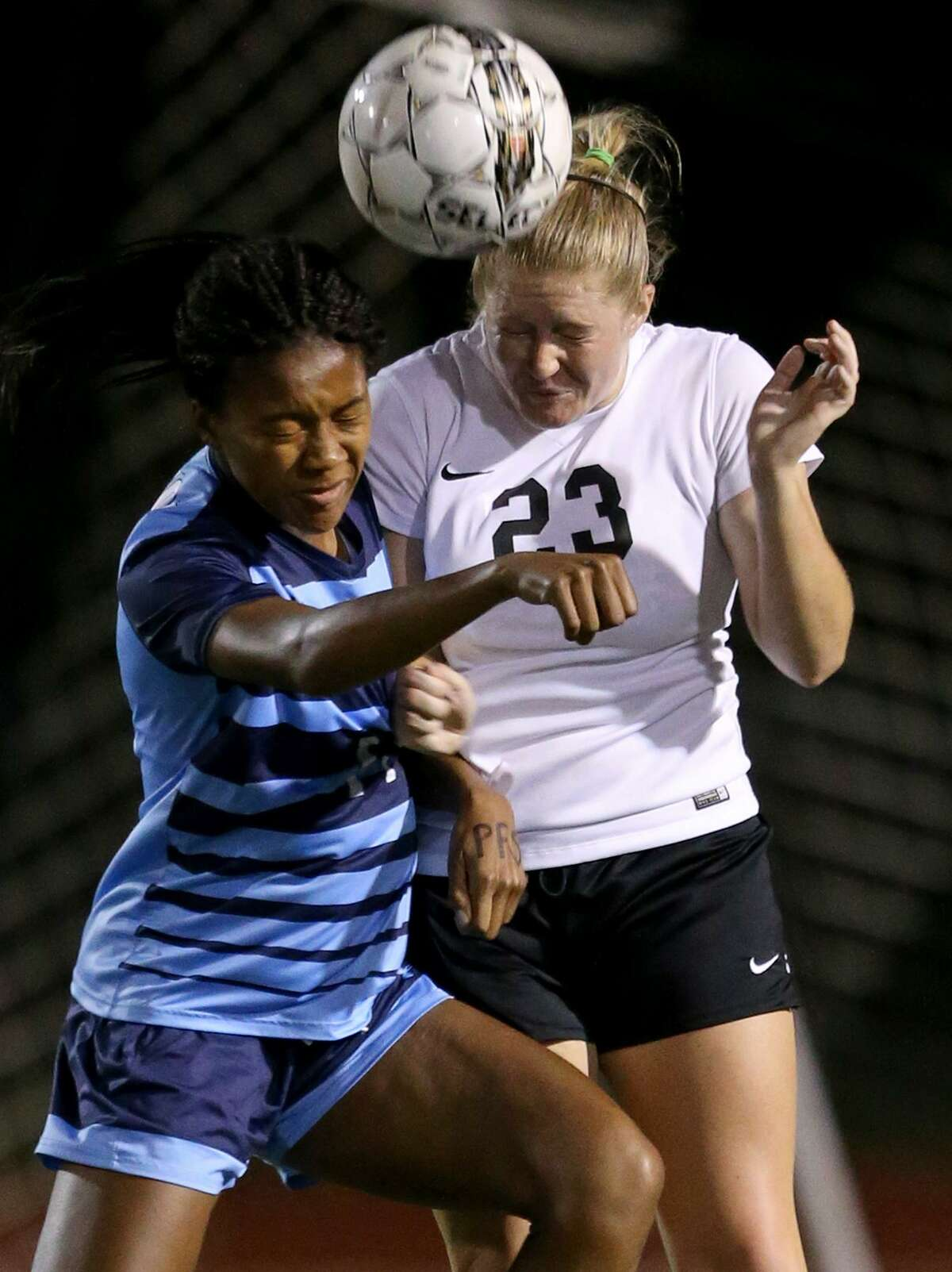 Johnson's Khori Banks (left) and Steele's Maggie Ryan go up for a header during their Class 6A second-round playoff game held Friday March 31, 2017 at Steele High School.