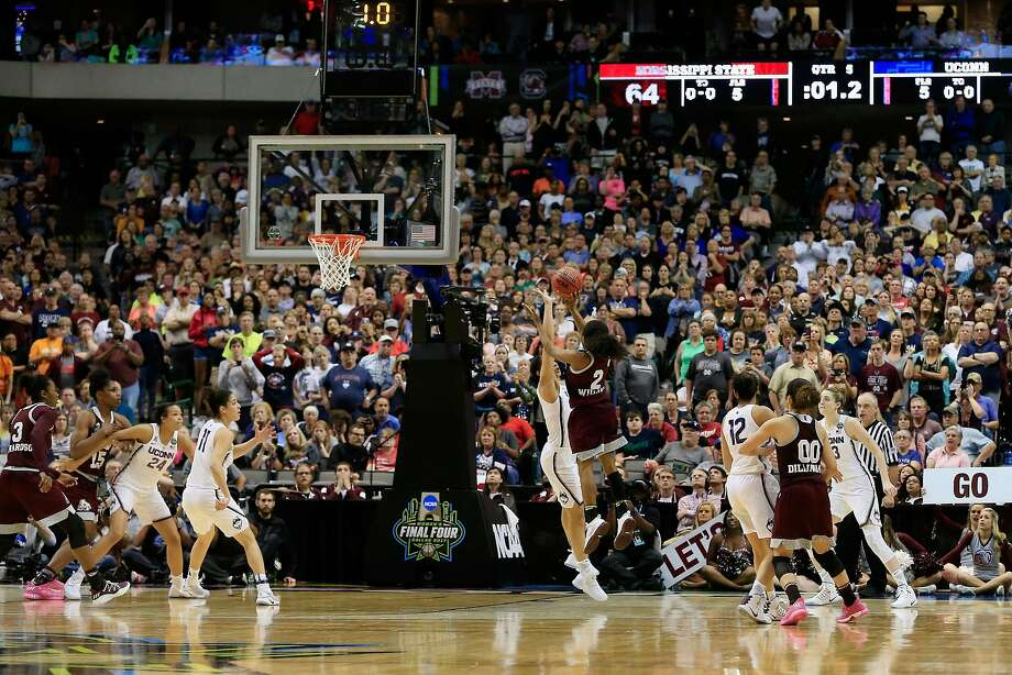 Mississippi State point guard Morgan William launches a 15-foot jumper to beat the overtime buzzer — and Connecticut. Photo: Ron Jenkins, Getty Images