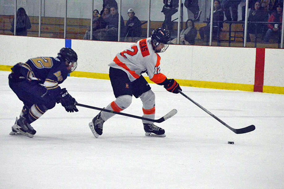 Edwardsville forward Stanley Lucas skates into the offensive zone with the puck late in the second period.