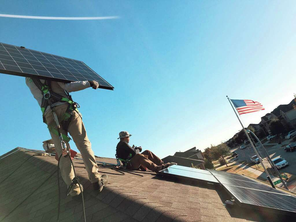 how to keep on the sunny side of solar power houston chronicle workers install a solarcity rooftop solar system at a home in the dallas area solarcity