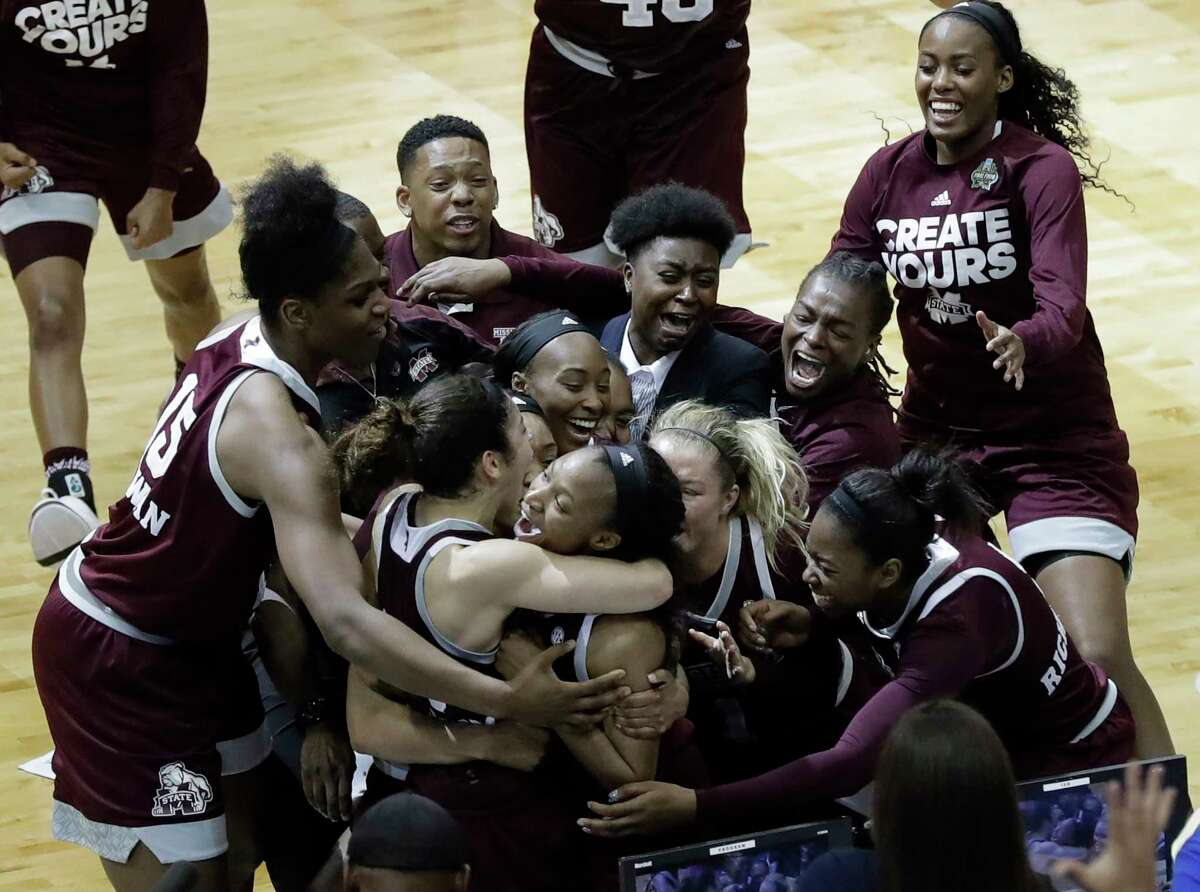 Mississippi State guard Morgan William, center, celebrates with teammates after she hit the winning shot at the buzzer in overtime to defeat Connecticut in an NCAA college basketball game in the semifinals of the women's Final Four, Friday, March 31, 2017, in Dallas. Mississippi State won 66-64. (AP Photo/Eric Gay)