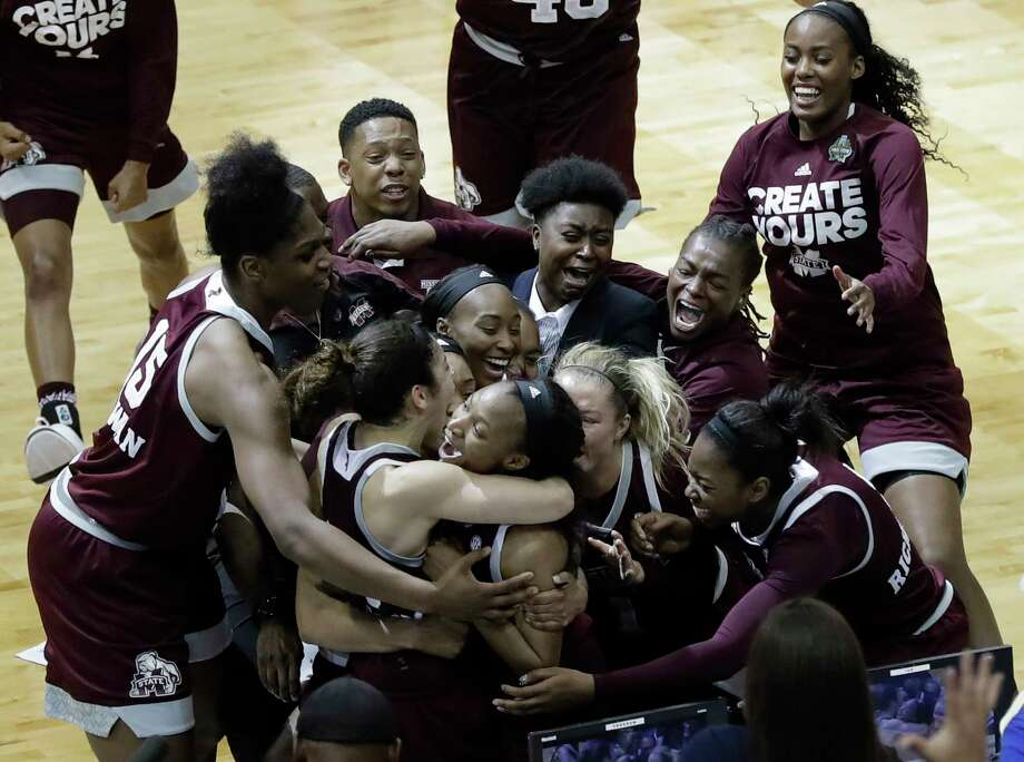 Mississippi State guard Morgan William, center, celebrates with teammates after she hit the winning shot at the buzzer in overtime to defeat Connecticut in an NCAA college basketball game in the semifinals of the women's Final Four, Friday, March 31, 2017, in Dallas. Mississippi State won 66-64. (AP Photo/Eric Gay) Photo: Eric Gay, Associated Press / Associated Press