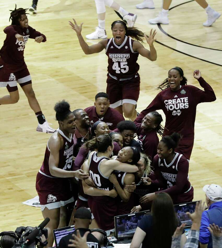 Mississippi State guard Morgan William, center, celebrates with teammates after she hit the winning shot at the buzzer in overtime to defeat Connecticut in an NCAA college basketball game in the semifinals of the women's Final Four, Friday, March 31, 2017, Friday, March 31, 2017, in Dallas. Mississippi State won 66-64. (AP Photo/Eric Gay)