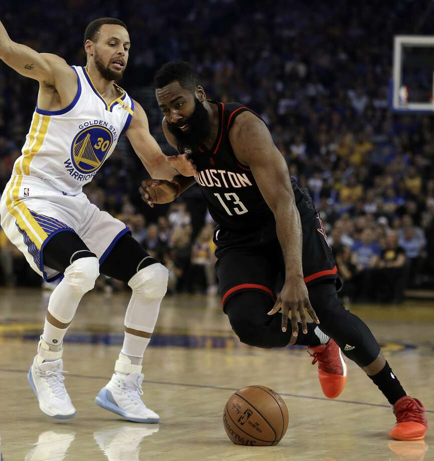 Houston Rockets' James Harden, right, drives the ball against Golden State Warriors' Stephen Curry (30) during the first half of an NBA basketball game Friday, March 31, 2017, in Oakland, Calif. (AP Photo/Ben Margot) Photo: Ben Margot/Associated Press