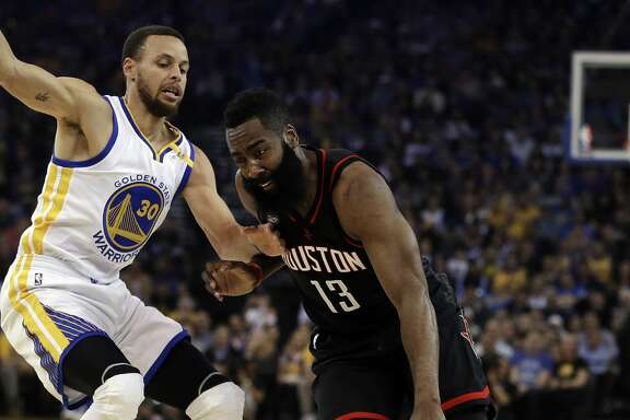 Houston Rockets' James Harden, right, drives the ball against Golden State Warriors' Stephen Curry (30) during the first half of an NBA basketball game Friday, March 31, 2017, in Oakland, Calif. (AP Photo/Ben Margot)
