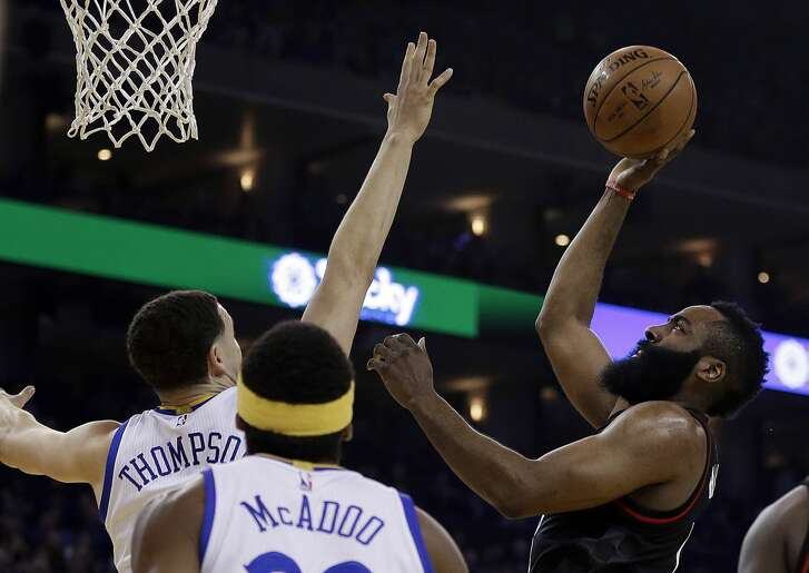 Houston Rockets' James Harden, right, shoots against Golden State Warriors' Klay Thompson during the first half of an NBA basketball game Friday, March 31, 2017, in Oakland, Calif. (AP Photo/Ben Margot)