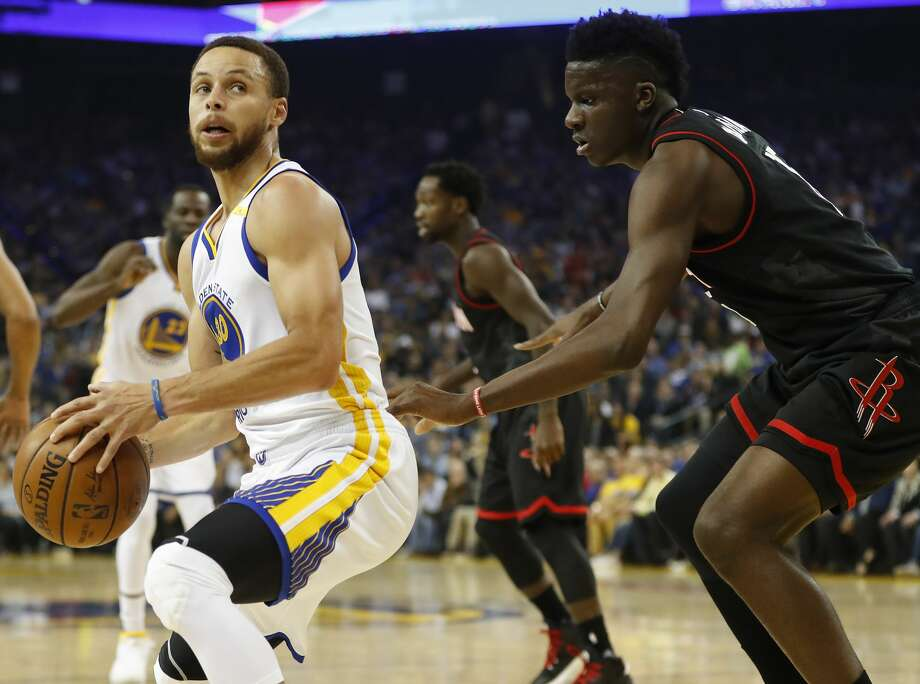The Warriors' Stephen Curry has thrived at Toyota Center of late while the Rockets' Clint Capela has been racking up blocked shots in his past two playoff games. Photo: Stephen Lam/Special To The Chronicle