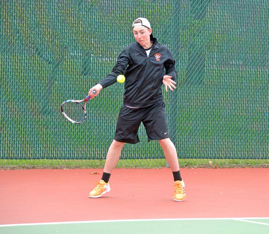Edwardsville's Logan Pursell makes a forehand return during a No. 2 singles match against Chatham Glenwood on Friday in the Tiger Invitational at EHS.