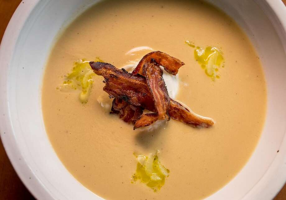 Cream of celery soup with a Riverdog Farm poached egg and bacon on top at the Wolf in Oakland. Photo: John Storey, Special To The Chronicle
