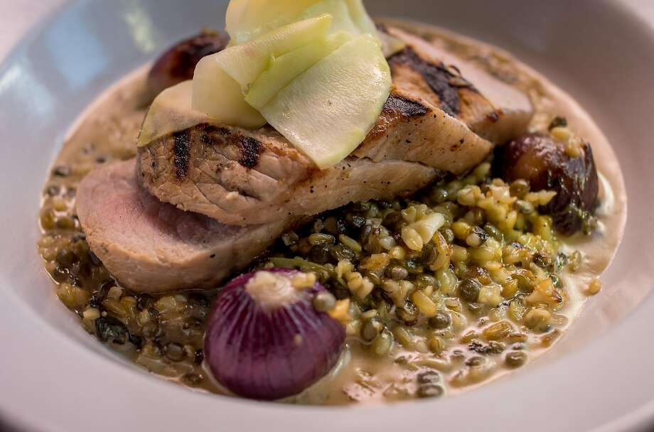 Grilled Niman Ranch pork loin at the Wolf. Photo: John Storey, Special To The Chronicle