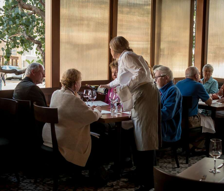 People have dinner at the Wolf in Oakland. Photo: John Storey, Special To The Chronicle