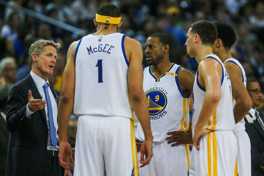 Coach Steve Kerr (left) talks to his Golden State Warriors players during a time out in the third quarter of an NBA basketball game against the Houston Rockets at Oracle Arena in Oakland, Calif. on Friday, March 31, 2017. The Warriors defeated the Rockets 107-98. Photo: Gabrielle Lurie, The Chronicle