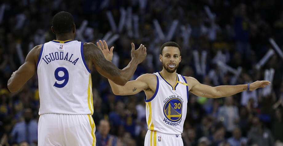 Golden State Warriors' Stephen Curry, right, celebrates a score with Andre Iguodala (9) during the second half of an NBA basketball game against the Houston Rockets Friday, March 31, 2017, in Oakland, Calif. Warriors won 107-98. (AP Photo/Ben Margot) Photo: Ben Margot/Associated Press