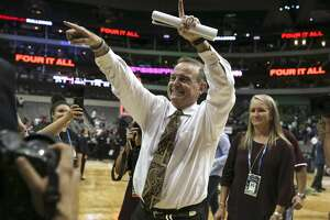 Mississippi State head coach Vic Schaefer gestures to fans as he leaves the court after a 66-64 win against Connecticut in an NCAA Tournament semifinal at American Airlines Center in Dallas on Friday, March 31, 2017. (Richard W. Rodriguez/Fort Worth Star-Telegram/TNS)