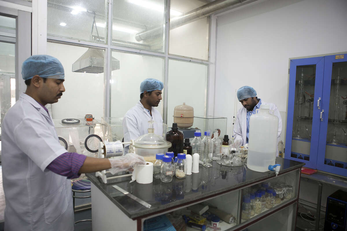 Research assistants work at the reversible inhibition of sperm under guidance (RISUG) male contraceptive treatment research and development laboratory at the Indian Institute of Technology Kharagpur in Kharagpur, West Bengal, India, on Feb. 16, 2017.