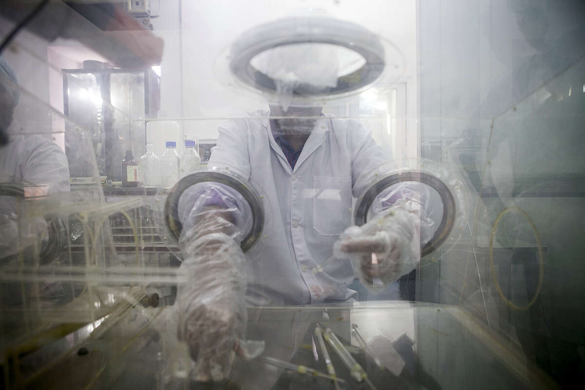 A research assistant prepares syringes inside a pharmacy glovebox at the reversible inhibition of sperm under guidance (RISUG) male contraceptive treatment research and development laboratory at Indian Institute of Technology (IIT) Kharagpur in Kharagpur, West Bengal, India, on Feb. 16, 2017. A new birth control method for men has the potential to win as much as half the $10 billion market for female contraceptives worldwide and cut into the $3.2 billion of annual condom sales, businesses dominated by pharmaceutical giants Bayer AG, Pfizer Inc. and Merck & Co., according to estimates from the last major drug company to explore the area. Photographer: Sumit Dayal/Bloomberg