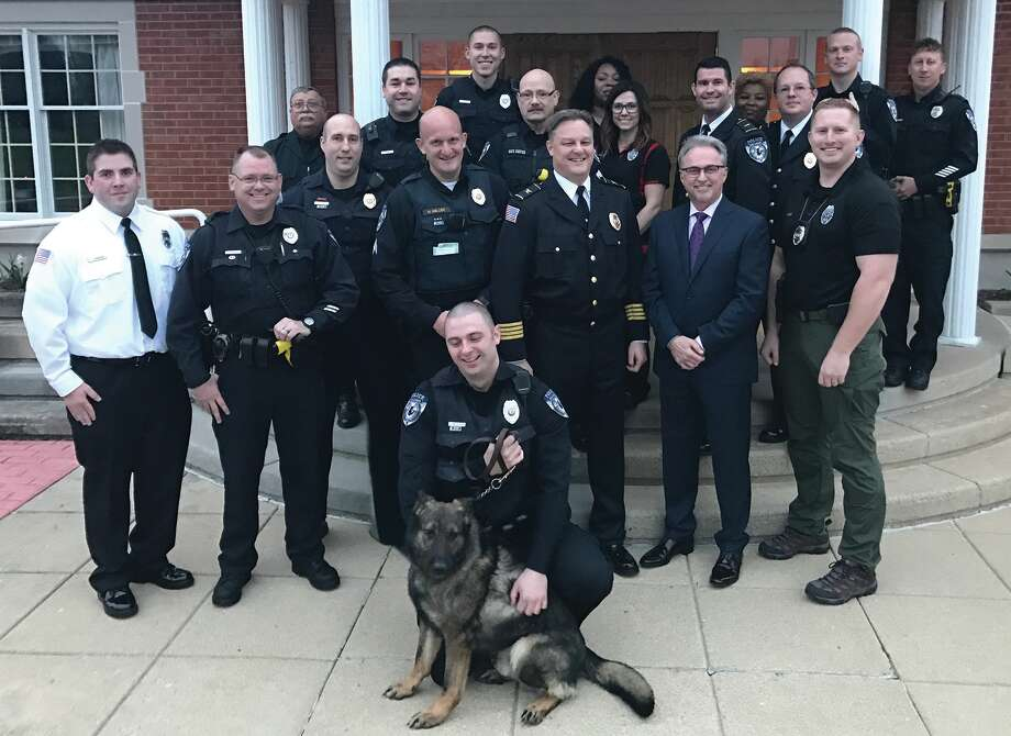 "New Glen Carbon K9 Officer ""A'to"" is pictured with his handler Officer Louis Mitchelar and members of the Glen Carbon Police Department. Dr.  Mark Eavenson, pictured second row, second from right, donated $15,000 to the department in support of the K9 program. Photo: For The Intelligencer"