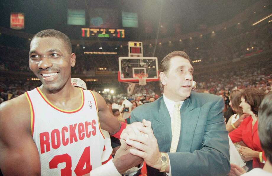 Hakeem Olajuwon and Rockets coach Rudy Tomjanovich celebrate after the team won its second consecutive NBA championship June 14, 1995 with a sweep of Orlando.  Click through the gallery to revisit 20 memorable moments from the Rockets' two championship runs. Photo: Rick Bowmer / Associated Press, STF / 1995 AP