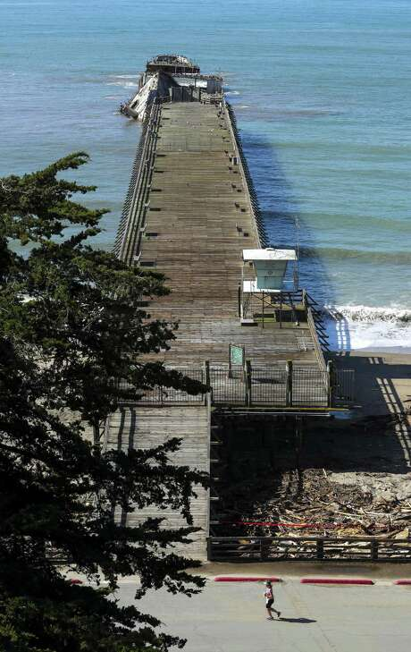 The broken, battered Cement Ship rests near the end of the pier in Aptos. Photo: Michael Macor / The Chronicle / ONLINE_YES