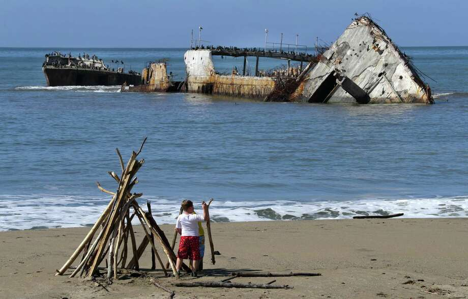 The Cement Ship, also known as the Palo Alto, sits battered just off Seacliff State Beach in Aptos. Photo: Michael Macor / The Chronicle / ONLINE_YES