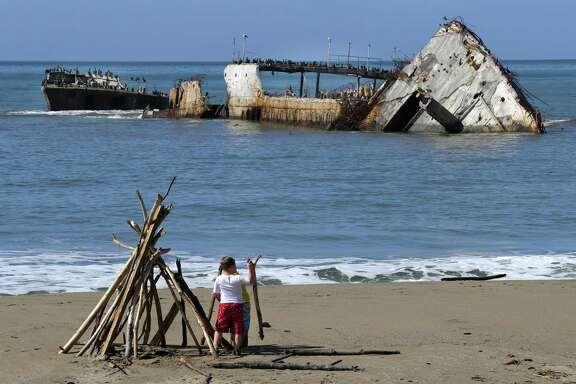 The SS Palo Alto, is seen just off shore broken apart at Seacliff State Beach, in Aptos, Ca., on Mon. March 27, 2017 after being damaged by winter storms.
