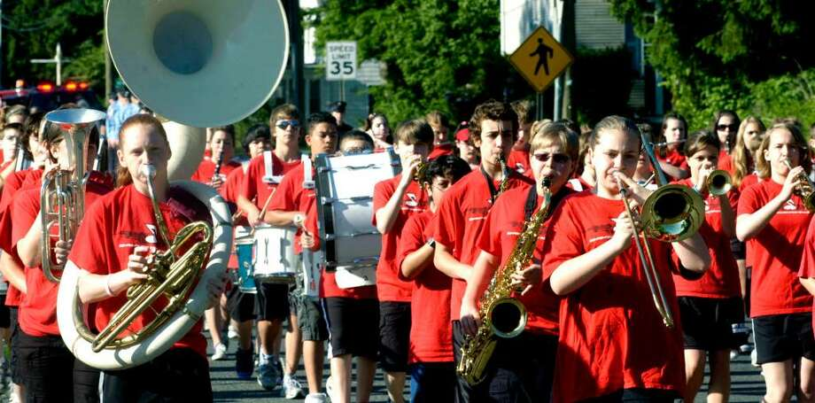 SPECTRUM/Maggie Grubb on sousaphone, Nicole Callisen on trombone and Kurt Freda on tenor saxophone are among those in the Schaghticoke Middle School marching band as they perform in the Memorial Day parade in Gaylordsville, in New Milford, May 31, 2010 Photo: Norm Cummings / The News-Times