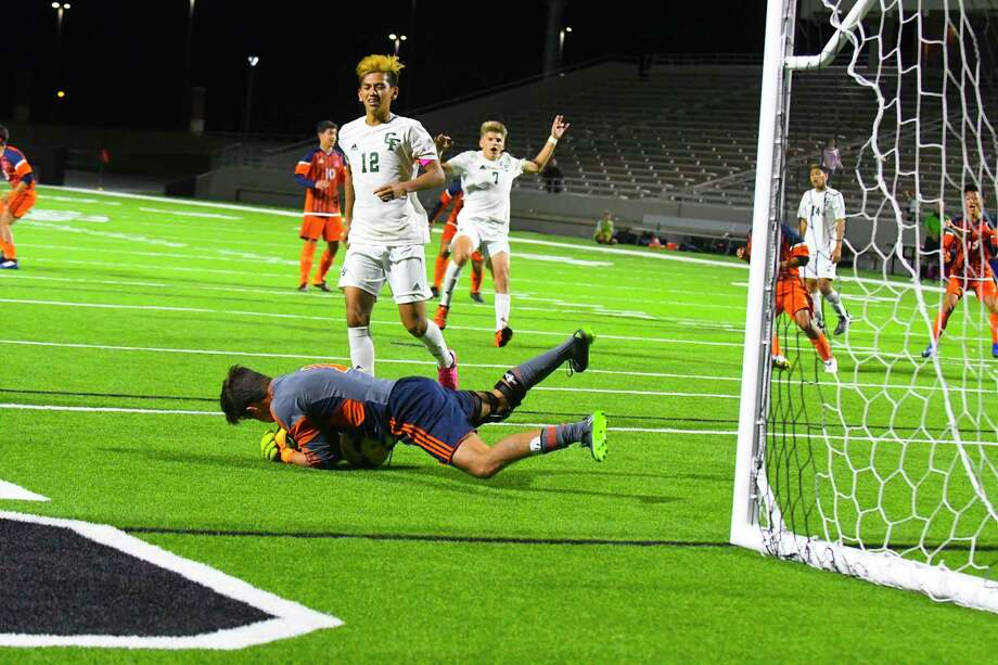 Seven Lakes keeper Charlie Beck stops the second of consecutive penalty kicks during the final three minutes of a 1-0 Seven Lakes area playoff victory at Pridgeon Stadium , 03/31/2017 Cypress, Tx. Photo: Tony Gaines, Photographer