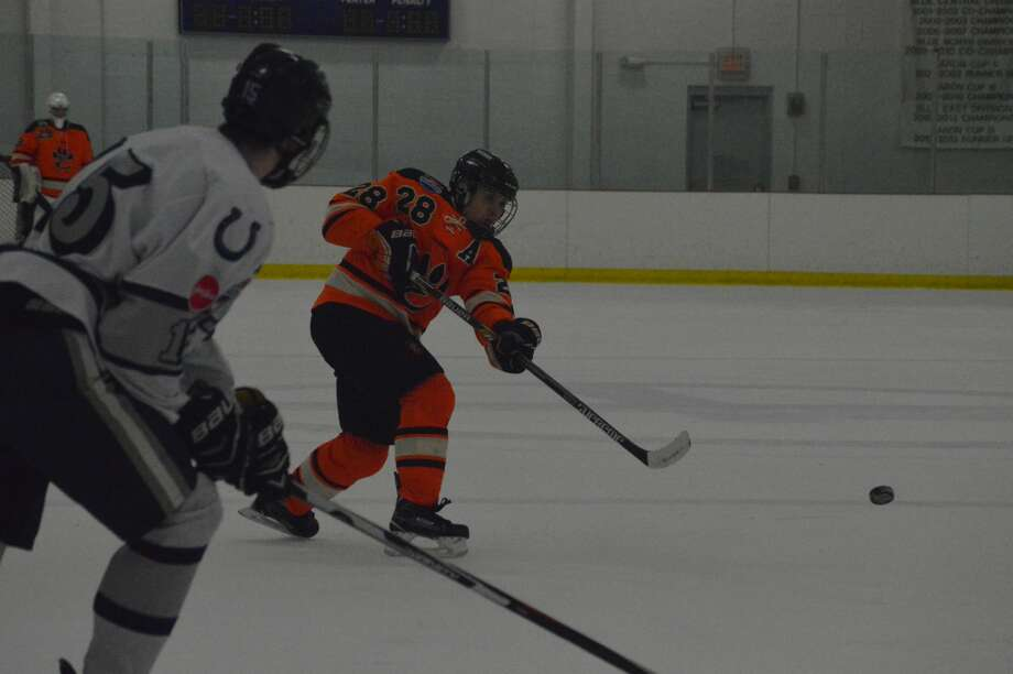 EHS defenseman Rory Margherio unloads on a slap shot in the first period.